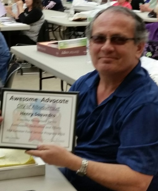 Henry Saavedra holding Awesome Advocate award for SFSP.